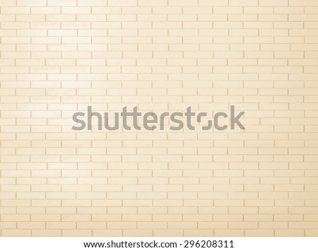 Brick wall tile texture background painted in yellow cream color tone: Tiled brick wall in light yellow beige cream tone     - stock photo