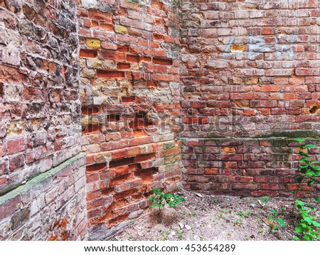 Brick wall, weathered, worn wall damaged paint. Grunge Concrete Surface. Great background or texture. - stock photo