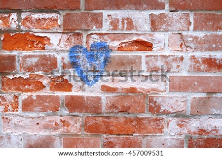 brick wall with a blue heart