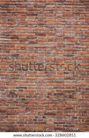 Brick wall with a lot of character - stock photo