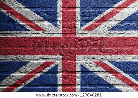 Brick wall with a painting of a flag isolated, UK - stock photo