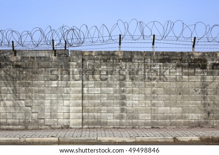 Brick Wall Fence Designs South Africa : Brick Wall With Barbed Wire Stock  Photo