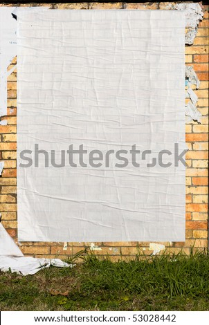 brick wall with blank poster and torn posters - empty banner