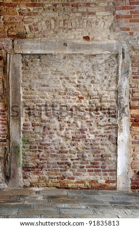 Brick wall with frame of old weathered wood
