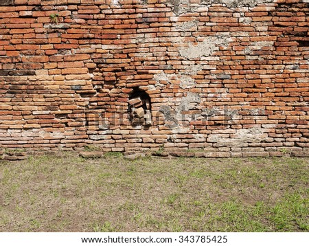 brick wall with grass floor