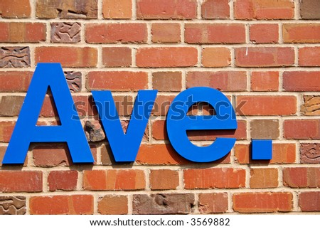 "Brick wall with inscription ""Ave."" - stock photo"