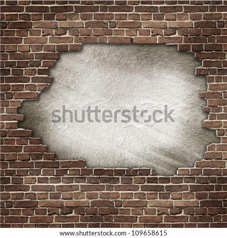 brick wall with large hole - stock photo