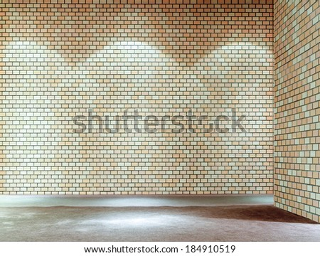brick wall with light spots background - stock photo