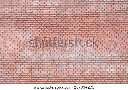 Brick wall with obsolete door bricked up - stock photo