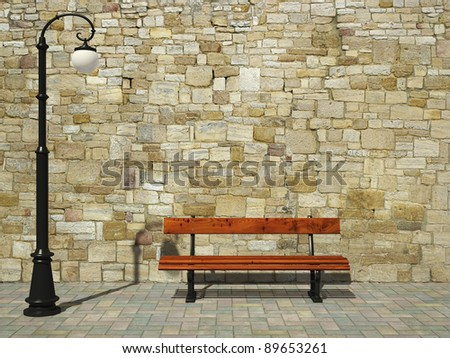 Brick wall with old fashioned street light and bench - stock photo