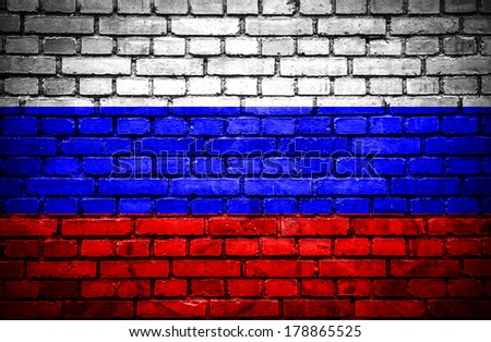 Brick wall with painted flag of Russia - stock photo