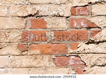 brick wall with peeling plaster (vertical) - stock photo