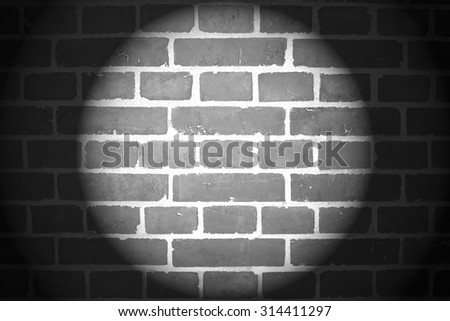 Brick Wall With Spotlight In Black And White Background