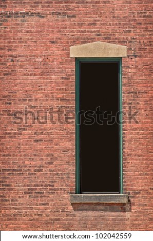 Brick Wall with Tall Dark Window for your copy, clipping path - stock photo