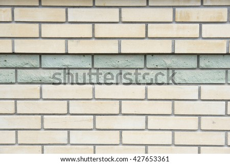brick wall with turquoise stripe,background - stock photo