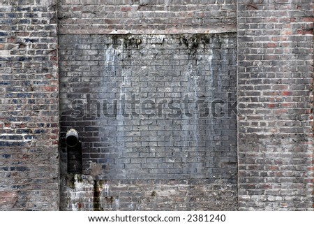 Brick wall with waste pipe. Ideal background.