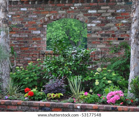 Brick wall with window and flower bed