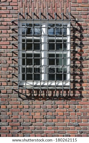 Brick Wall with Window Wrought Iron Guard - stock photo