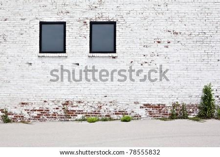 brick wall with windows background - stock photo