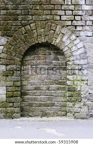 Brick walled arch - stock photo