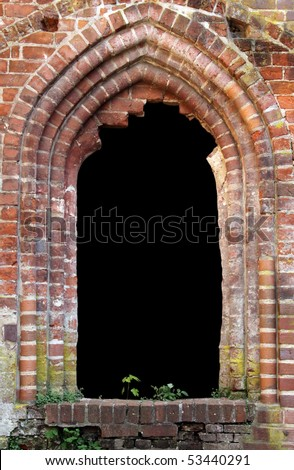 Brick window as a grungy frame, isolated on black background in the centre