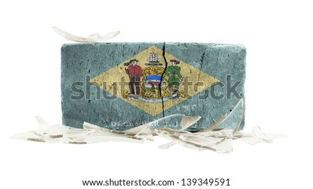 Brick with broken glass, violence concept, flag of Delaware