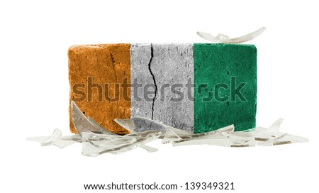 Brick with broken glass, violence concept, flag of Ivory Coast