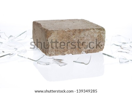 Brick with broken glass, violence concept, isolated on white - stock photo