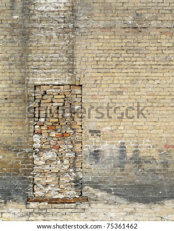 Bricked up window with vintage grunge brick wall - stock photo