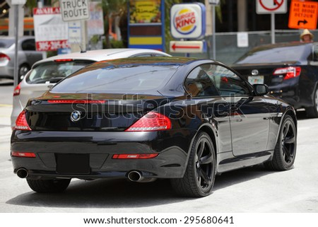 BRICKELL - JULY 5: Stock image of a 2015 BMW 6 series hart top convertable on the streets of Brickell. BMW is a german auto manufacturer founded in 1916 July 5, 2015 in Brickell FL - stock photo
