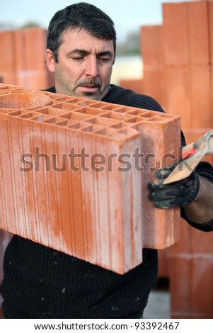 Bricklayer on site - stock photo