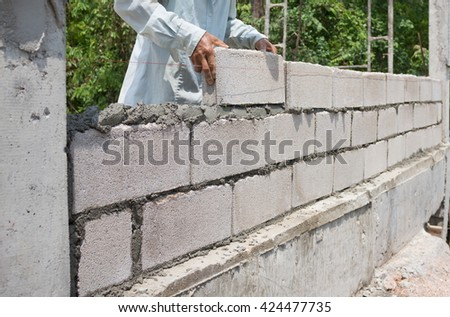 bricklayer worker - stock photo