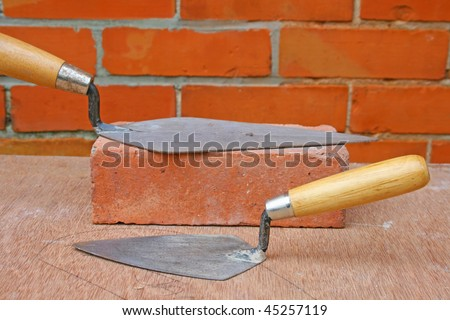 bricklayers trowels - stock photo