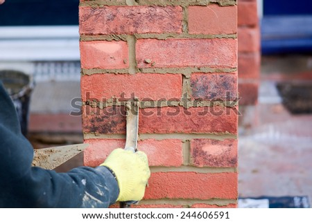 Bricklaying - pointing render on gate post - stock photo