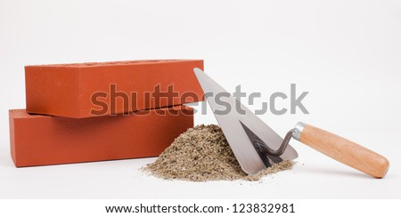 bricks and mason tools isolated on white - stock photo