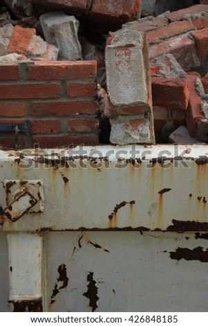 Bricks in a dumpster near a construction site, home renovation - stock photo