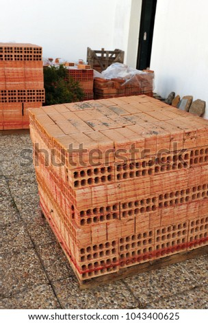 Bricks stacked outside prepared for the reform of the house
