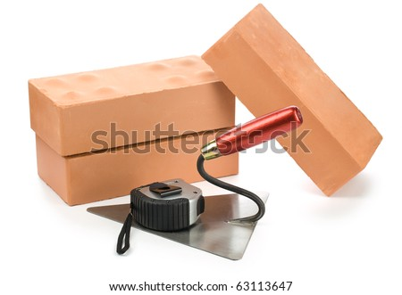 bricks tapeline and trowel - stock photo