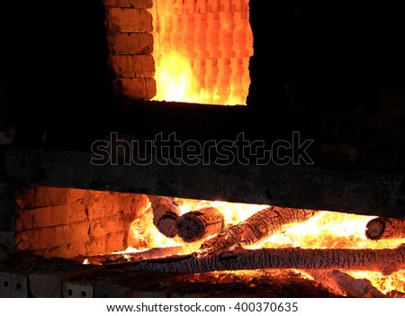 Brickwork with firewood is burning in red, make exhaust fumes when use firewood to burn, CO2 make pollution environment, Vietnam
