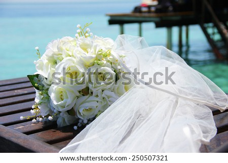 bridal bouquet at sea  - stock photo