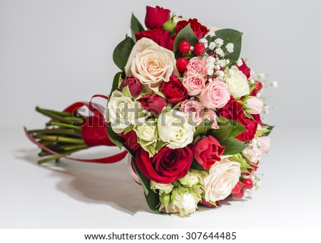 Bridal bouquet, bridal bouquet in red colors. Shallow depth - stock photo