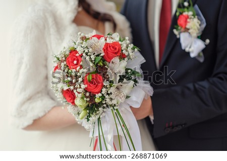 bridal bouquet close up in the hands of the bride and groom. - stock photo