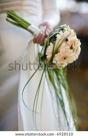 Bridal bouquet holding by the bride - small DOF. - stock photo