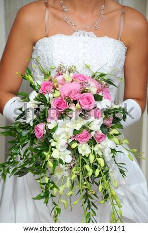 Bridal bouquet in bride's hands - stock photo