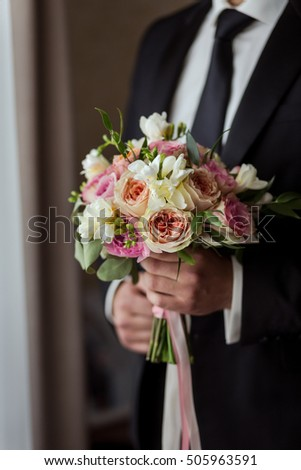 bridal bouquet in hands, wedding bouquet in hands of the groom, groom morning, businessman, wedding, man's fashion, man's style