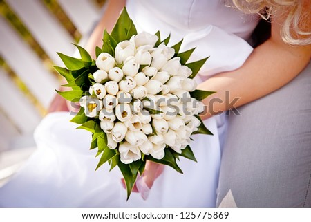 Bridal Bouquet in the bride hands - stock photo