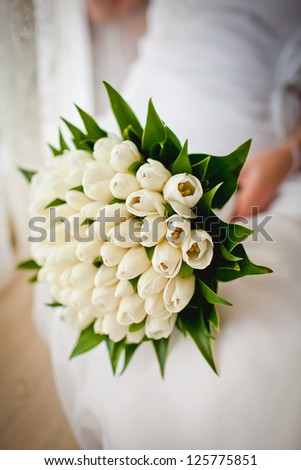 Bridal Bouquet in the groom hands - stock photo