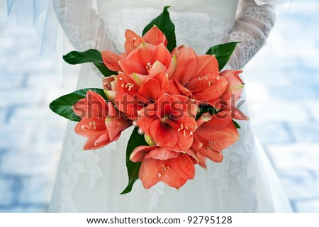 bridal bouquet in the the bride's hands - stock photo