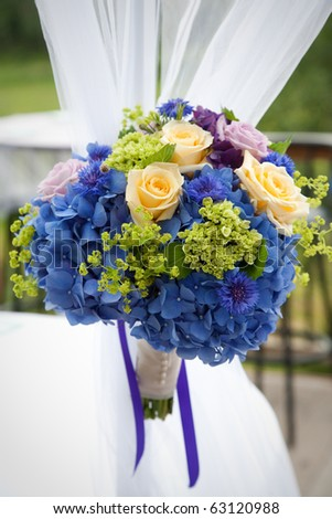 Bridal bouquet made from multi-colored flowers - stock photo