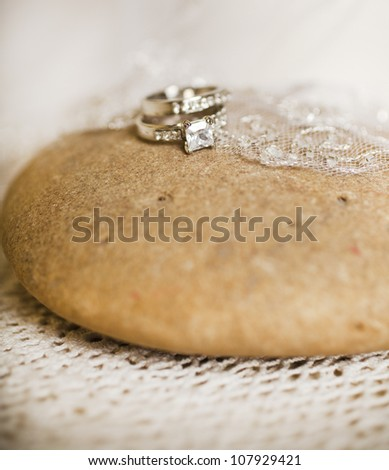 Bridal bouquet of roses with wedding and engagement rings - stock photo